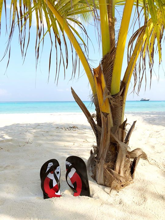 Surfin' makes us feel good . Greetings from the Maldives